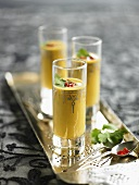 Middle Eastern pumpkin soup in glasses on silver tray
