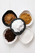 Various types of sugar in small dishes