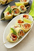 Pancake rolls with dill cream & smoked salmon filling on skewers