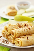 Pancakes with peanut butter, chopped nuts and apple slices