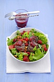 Salad leaves with fried turkey liver and raspberry dressing