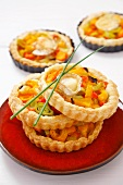 Goat's cheese and vegetable puff pastry tartlets