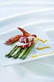 Lobster on green asparagus