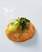 Salmon ravioli with spring onion and basil