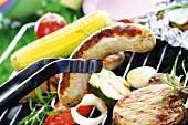 Meat, sausage and vegetables on barbecue