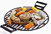Sausages and vegetables on barbecue rack