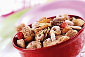 Muesli with dried fruit and almonds in a bowl