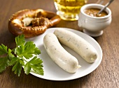 Bavarian veal sausages with pretzel and sweet mustard