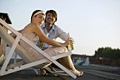 Young couple with drinks on a roof terrace