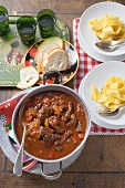 Beef goulash with peppers and wide ribbon pasta