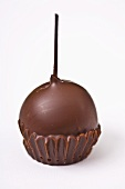 A chocolate-dipped cherry