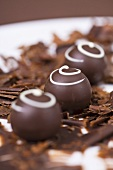Chocolates on chocolate shavings
