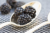 Blackberries on a silver spoon