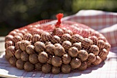 Macadamia nuts in a net bag