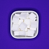 Sugar cubes in a square bowl (overhead view)