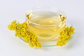 Lady's bedstraw tea in glass cup and saucer