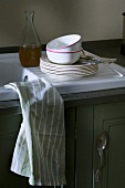 Crockery on draining board
