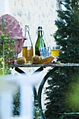 Autumn decorations & Federweisser (young wine) on garden table
