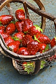 Artificial strawberries in wire basket