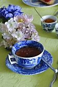 A cup of tea and floral decoration