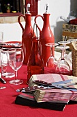 Table laid in red on a terrace