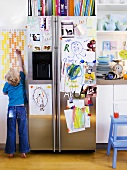 Refrigerator covered in children's pictures