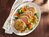 Rump steak with mushroom crust and vegetables