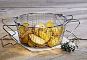 Potato wedges in frying basket