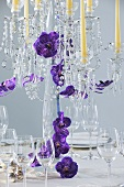 Candelabrum with flowers on table laid for special occasion