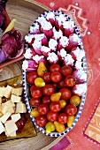 Radishes stuffed with soft cheese, cherry tomatoes
