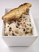 Matjes herring fillets with onions, capers and bread