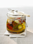 Pickled vegetables in preserving jar with fork