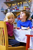 Children eating breakfast in kitchen