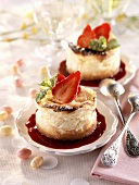 Individual cheesecakes on berry sauce