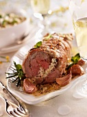 Rolled roast lamb with goat's cheese and mint