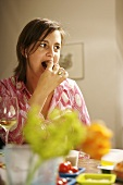 Woman eating finger food
