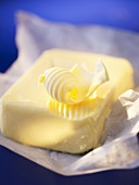 A block of butter with a butter curl