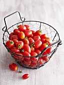 Cherry tomatoes in a wire basket