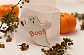 Paper bag candle lanterns and ghost biscuit for Halloween