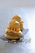 Profiteroles with honey cream, orange icing & flaked almonds