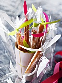 Caramel sticks in cellophane wrappers