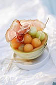Charentais melon balls with raw ham