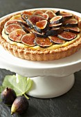 Fig tart on cake stand