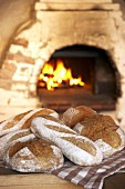 Freshly baked rustic bread in front of oven