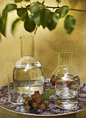 Water and blackberries in glasses and carafes
