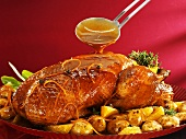 Duck with orange sauce and potatoes