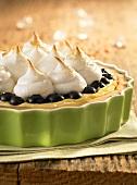 Lemon tart with vanilla cream, blueberries and meringue