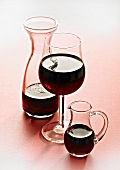 Red wine in glass and carafes