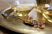 Tea and brown sugar crystals