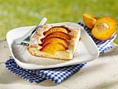 Piece of peach cake on plate